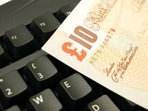 10 pound note on a keyboard Royalty Free Stock Photos