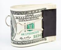 10 tausend US-Dollars befestigen sich mit Papierklammer Stockfotografie