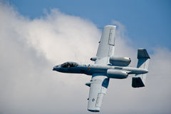 A-10 Thunderbolt II aircraft. American A-10 Thunderbolt II military jet aircraft banking royalty free stock photo