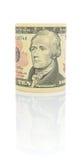 10 U.S.-dollar på en vitbakgrund Arkivfoto