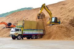 Free 10 Wheels Truck Is Loading Wood Chip At Stock Piles Ready To Load To Vessel For Export. Paper And Biomass Industries. Royalty Free Stock Images - 119686039