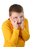10 year old boy pleasantly surprised isolated Stock Image