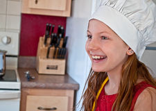 10 Year Old Happy Girl with Chef's Hat Royalty Free Stock Photos
