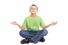 10 years old boy meditating Royalty Free Stock Images