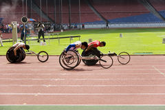 100人米赛跑s轮椅 免版税库存图片