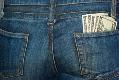 100件钞票牛仔裤矿穴后方 免版税库存照片