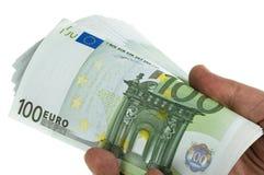 100 ευρο- στοίβα χεριών Στοκ Φωτογραφίες