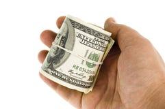 100 долларов крена изолированного рукой Стоковые Фото