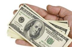 100 долларов руки Стоковая Фотография