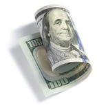 Свернутый 100 долларовым банкнотам Стоковое Изображение RF