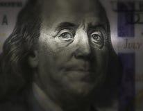 在美国$ 100的票据的本富兰克林的面孔 免版税图库摄影