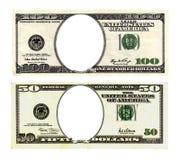 100 и 50 долларов счетов на белой предпосылке Стоковые Изображения RF