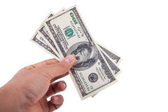 供以人员拿着100美金的手被隔绝在白色背景 库存照片