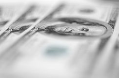 $100 banknotes background. $100 banknotes background with extremally shallow depth of field Royalty Free Stock Image