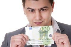 100 cuentas euro en las manos masculinas Foto de archivo libre de regalías