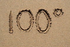 100 degrees. 100 degrees written on a sandy beach Stock Images