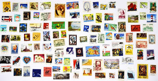 100 different stamps from around the world royalty free stock photos
