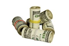 100 dólares de rolos isolados no branco Foto de Stock