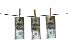100 dollar. Banknote drying on a rope Royalty Free Stock Photo