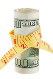 100 dollar bank note and tape measure Stock Photo
