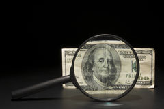 100 Dollar Bill. A 100 dollar bill under a magnifying glass royalty free stock photo