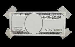 100$ dollar bill and adhesive tape isolated Royalty Free Stock Photo