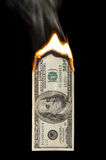 100 Dollar Bill On Fire. Image of a one hundred dollar bill on fire Royalty Free Stock Photography