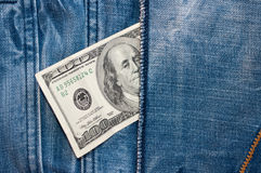100 dollar-bill in the jeans pocket Royalty Free Stock Photo