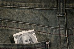 100 dollar bill in pocket Stock Images