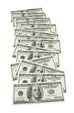 100 dollar bills. Several 100 dollar bills spread out in a row, on white background Stock Photo