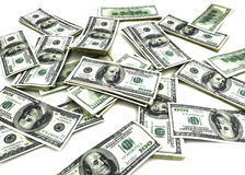 100 Dollar Bills. Scattered on plain white background Royalty Free Stock Images