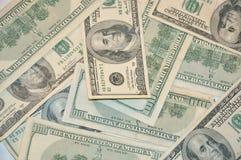 $100 dollar bills. A background of many hundred dollar bills Royalty Free Stock Photo
