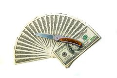 100 dollar bills fan stack and knife. 100 dollar bills on a white background. Fan stack. Knife royalty free stock photos