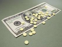 100 Dollar and pills Stock Image