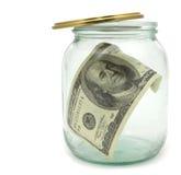 100 dollari in un vaso di vetro Immagini Stock