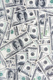 100 dollars banknotes. Many 100 dollars banknotes for use as background royalty free stock photos