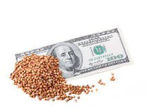 100 Dollars and buckwheat groats Stock Image
