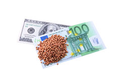 100 Dollars and buckwheat groats Stock Photography