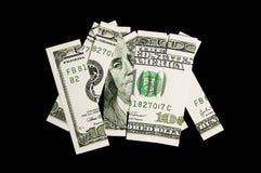 100 Dollarschein in den Stücken Lizenzfreies Stockfoto