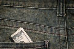 100 Dollarschein in der Tasche Stockfoto