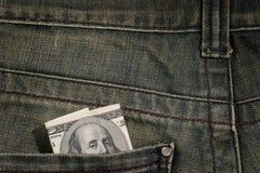 100 Dollarschein in der Tasche Stockbilder
