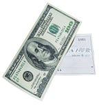 100 Dollarschein und Bankscheck Stockfoto
