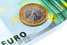 100 euro and  1 euro. 100 euro banknote and coin of 1 euro. A collage of three photos. Focus on the coin Royalty Free Stock Photography