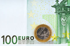 100 euro and  1 euro. 100 euro banknote and coin of 1 euro Royalty Free Stock Photos