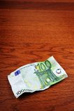 100 euro banknote. On a table Stock Photo