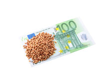 100 Euro and buckwheat groats Royalty Free Stock Images