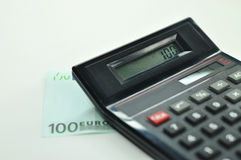 100 Euro + Calculator Stock Photography