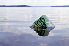 100 euro note sinking. 100-euro note sinking into the water, shot on a lake Royalty Free Stock Photo