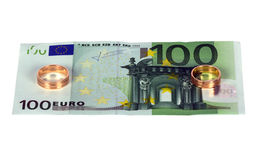 100 euro with two wedding rings Royalty Free Stock Images