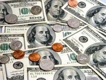 $100 factures et pièces de monnaie - têtes Images stock